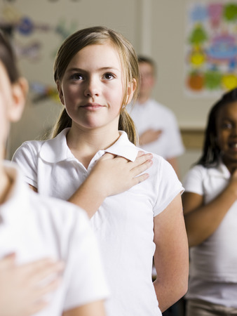 Girl Saying The Pledge Of Allegiance LANG_EVOIMAGES