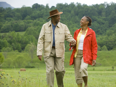 clothe: Senior Man And A Senior Woman Walking In A Field LANG_EVOIMAGES