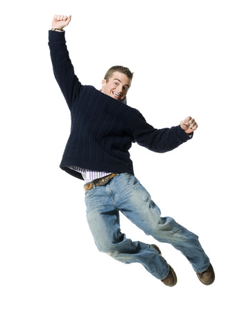 ebullient: Portrait Of A Young Man Jumping In Mid Air