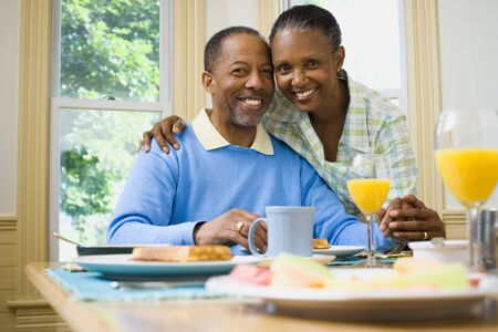 chequer: Portrait Of A Woman And A  Man Smiling At The Breakfast Table