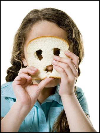 ebullient: Portrait Of A Girl Looking Through A Slice Of Bread LANG_EVOIMAGES