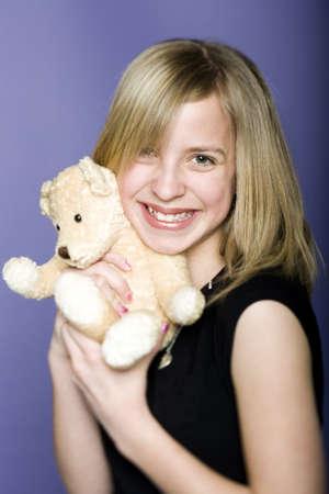 ebullient: Portrait Of A Girl Holding A Teddy Bear
