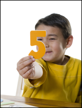 Portrait Of A Boy Holding A Number