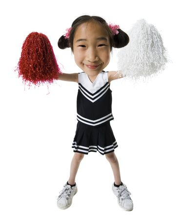 Portrait Of A Girl Standing And Holding Pom-Poms LANG_EVOIMAGES