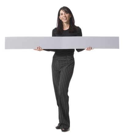 Portrait Of A Mid Adult Woman Holding A Blank Sign