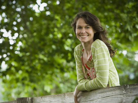 joyous: Portrait Of A Woman Leaning On A Wooden Fence LANG_EVOIMAGES