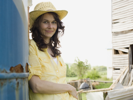 Portrait Of A Woman Wearing A Straw Hat