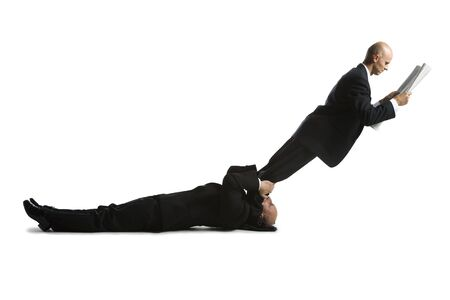 Profile Of Two Male Acrobats In Business Suits