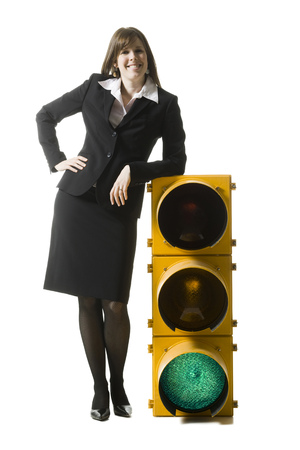 stop and go light: Businessperson Holding A Traffic Signal