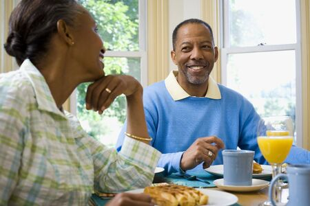 Senior Man And A Senior Woman Sitting At The Breakfast Table