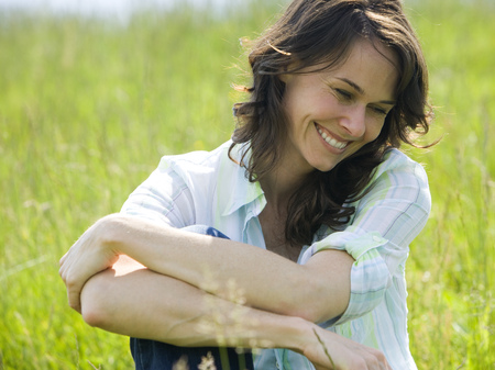 ebullient: Close-Up Of A Woman Smiling With Her Arms Crossed LANG_EVOIMAGES