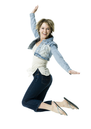 Portrait Of A Young Woman Jumping In Mid Air