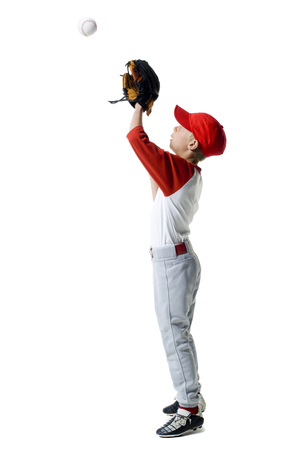 Profile Of A Baseball Player Standing In A Catching Position