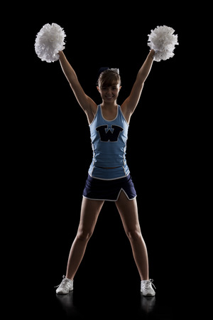 black cheerleader: Studio Shot Of Cheerleader (16-17) Striking Pose LANG_EVOIMAGES