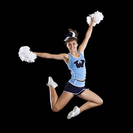 black cheerleader: Studio Shot Of Cheerleader (16-17) Jumping