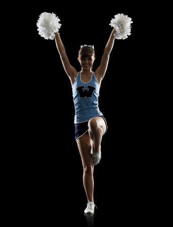 black cheerleader: Portrait Of Teenage Cheerleader Girl (16-17) Holding Pom-Poms