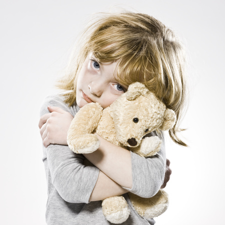 sickly: Girl Hugging Her Teddy Bear