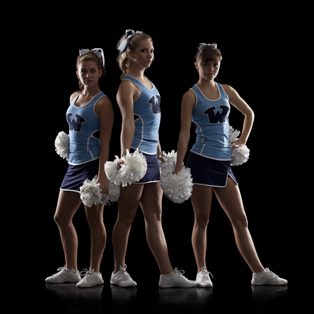 black cheerleader: Studio Shot Of Three Cheerleaders (16-17)