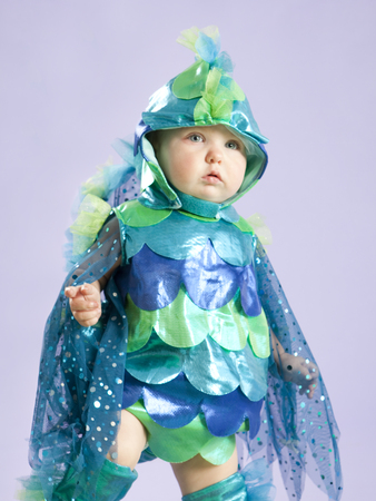 Portrait Of Baby Girl (12-17 Months) In Fish Costume For Halloween