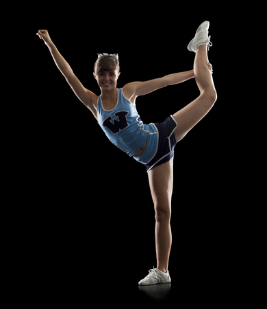 black cheerleader: Portrait Of Teenage Cheerleader Girl (16-17) Stretching