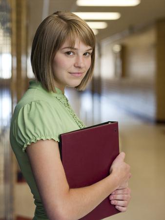 Usa,Utah,Spanish Fork,Portrait Of School Girl (16-17) Holding File In Corridor