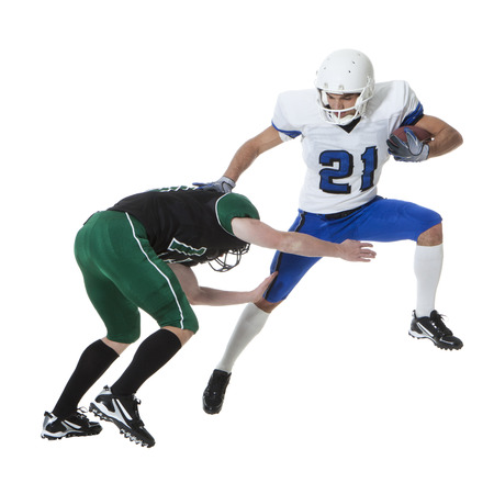 Two Male Players Of American Football Fighting For Ball,Studio Shot