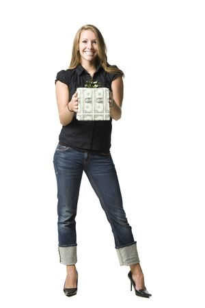 Studio Portrait Of Smiling Young Woman Holding Gift Wrapped In Us Banknotes