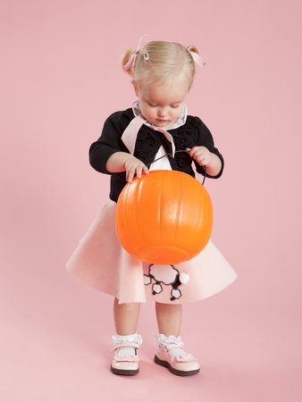 Baby Girl (12-17 Months) In 1950S Style Costume,Holding Pumpkin Lantern For Halloween