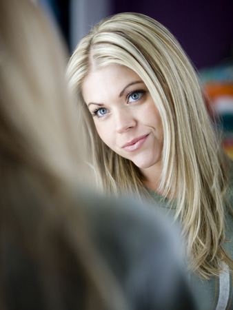 Reflection Of Young Blonde Woman