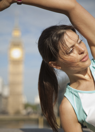 Uk,London,Woman Exercising In Front Of Big Ben
