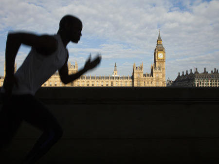 Uk,London,Man Running In Front Of Westminster Skyline LANG_EVOIMAGES