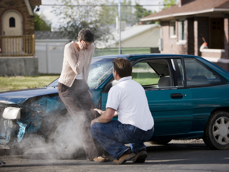 Man Helping A Woman After A Car Accident
