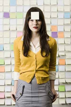 post it: Woman With A Post It Note On Her Forehead