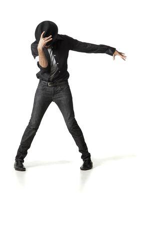 Man In Fedora Dancing In Studio