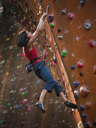 Usa,Utah,Sandy,Female Rockclimber On Indoor Climbing Wall LANG_EVOIMAGES