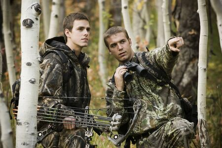 Two Men Hunting In The Wilderness LANG_EVOIMAGES