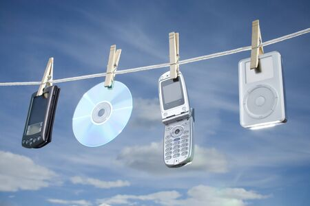 Electronic Gadgets Hanging On A Clothesline