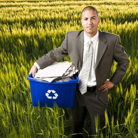 Businessman Holding A Recycling Bin LANG_EVOIMAGES