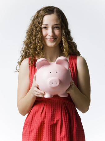 Woman Holding A Piggybank LANG_EVOIMAGES