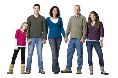 Studio Shot Of Family Holding Hands