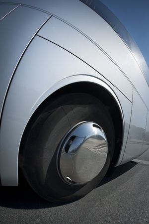 radial tire: Big wheel and tire close up on a white bus