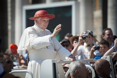 priesthood: Pope Benedict XVI blessing and waving at crowd from popemobile at vatican