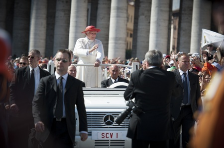 priesthood: Rome - Aprll 4, 2010  Pope Benedict XVI blessing and waving at crowd from popemobile during a gathering of international church servants on April 4th 2010 at Saint Peter