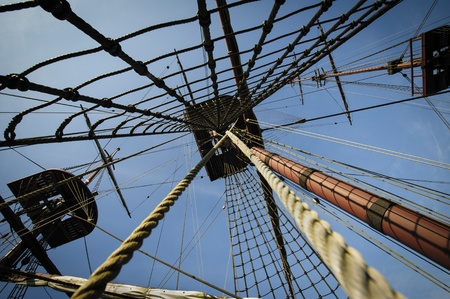 rigging: Three masts on tall merchant ship with ropes and ladders