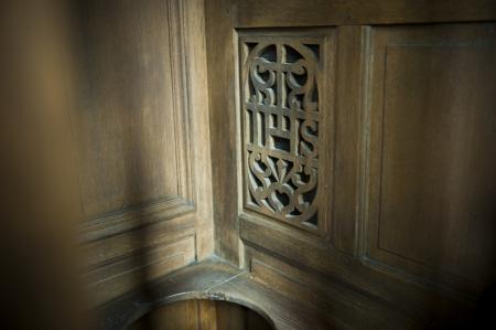 Confession booth in een kerk Stockfoto