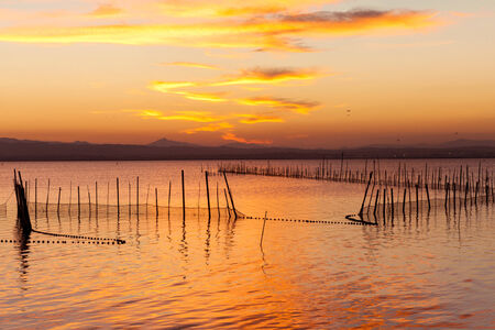 protagonists: Where laalbufera a sunset in the clouds and the colors are the Protagonists. Stock Photo