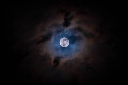 Full moon with clouds black background backdrop detail surface