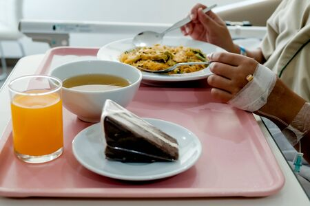 Patient in hospital with food, recovering in bed Stok Fotoğraf
