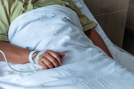 Patient in hospital in bed with emergency button