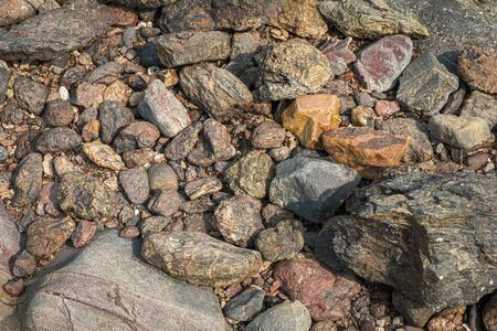 Background of stones in the beach, orange color